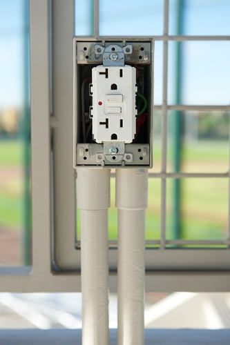 White electrical outlet with GFCI just after it was installed