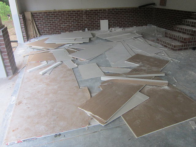 drywall scattered on the floor
